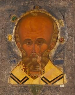 Икона «Святитель Николай Чудотворец (оплечный)», в окладе с надписью на обороте. XVI в.